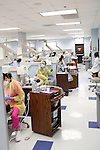 Dental hygiene students examine patients in the Georgia Perimeter College's Dunwoody Campus Dental Clinic in Dunwoody, Georgia October 6, 2011. The clinic is four days a week and there are 18 units that are often full of patients during the clinics.