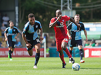 Goal scorer Aaron Amadi Holloway of Wycombe Wanderers and Stephane Zubar of York City (who's Own Goal made it 3-0) chase down the ball during the Sky Bet League 2 match between Wycombe Wanderers and York City at Adams Park, High Wycombe, England on 8 August 2015. Photo by Andy Rowland.