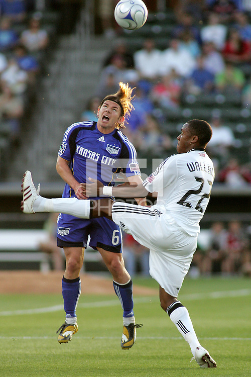 Lance Watson #6 goes up for a header despite the boot of Rodney Wallace..Kansas City Wizards tied 1-1 with DC United at Community America Ballpark, Kansas City, Kansas.