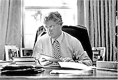 United States President Bill Clinton looks up from work at his desk in the Oval Office in the White House in Washington, D.C. on Monday, February 15, 1993.  Departing from tradition, the President uses the Oval Office as his primary work place..Credit: White House via CNP