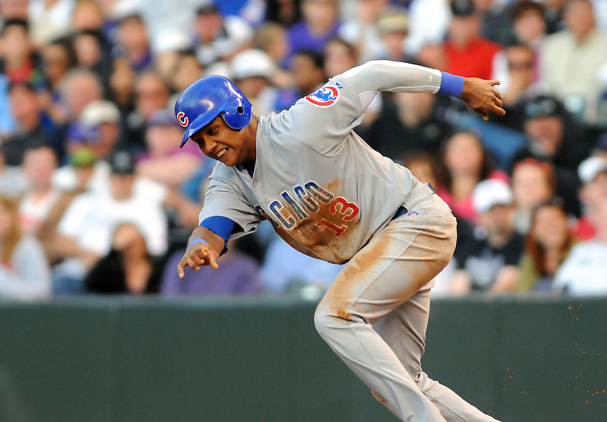 16 APRIL 2011:  Chicago Cubs shortstop Starlin Castro (13) attempts a steal during a regular season game between the Chicago Cubs and the Colorado Rockies at Coors Field in Denver, Colorado. The Bubs beat the Rockies 8-3.   *****For Editorial Use Only*****