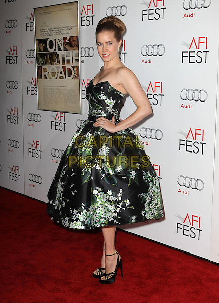 Amy Adams.AFI FEST 2012 'On The Road' gala screening, Grauman's Chinese Theatre, Hollywood, California, USA..3rd November 2012.full length dress  black strapless green floral print ankle strap shoes hands on hips side .CAP/ADM/KB.©Kevan Brooks/AdMedia/Capital Pictures.