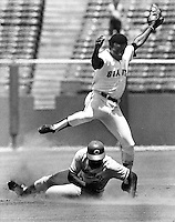 Giant second baseman Tito Fuentes steps over Reds Hal King to complete double play. (1973 photo by Ron Riesterer)