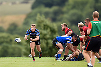 Chris Cook of Bath Rugby passes the ball against the visiting Dragons team. Bath Rugby pre-season training on August 8, 2018 at Farleigh House in Bath, England. Photo by: Patrick Khachfe / Onside Images