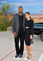 "LOS ANGELES, USA. October 08, 2019: Ron Artest & Maya Ford at the premiere of ""El Camino: A Breaking Bad Movie"" at the Regency Village Theatre.<br /> Picture: Paul Smith/Featureflash"