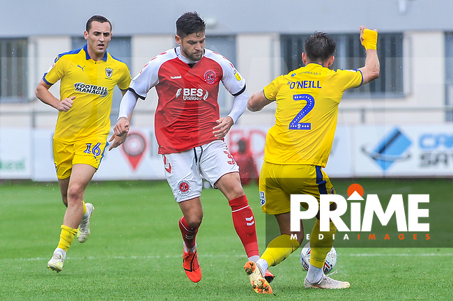 Fleetwood Town's defender Danny Andrew (3) stopped by Wimbledon's defender Luke O'Neil (2) during the Sky Bet League 1 match between Fleetwood Town and AFC Wimbledon at Highbury Stadium, Fleetwood, England on 10 August 2019. Photo by Stephen Buckley / PRiME Media Images.