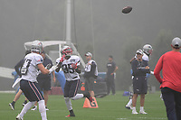 August 13, 2018: New England Patriots running back Mike Gillislee (35) gets under the ball in the fog at the New England Patriots training camp held on the practice fields at Gillette Stadium, in Foxborough, Massachusetts. Eric Canha/CSM