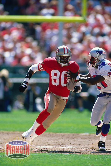 SAN FRANCISCO, CA - Jerry Rice of the San Francisco 49ers in action during a game against the New England Patriots at Candlestick Park in San Francisco, California in 1995. Photo by Brad Mangin