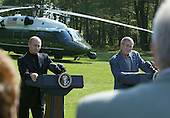 United States President George W. Bush, right, tells a Russian reporter that he can only ask one question during a news conference with President Vladimir Putin of Russia, September 27, 2003 at Camp David, Maryland. Putin arrived September 26 after attending official meetings at the United Nations in New York.  .Credit: Mark Wilson - Pool via CNP..