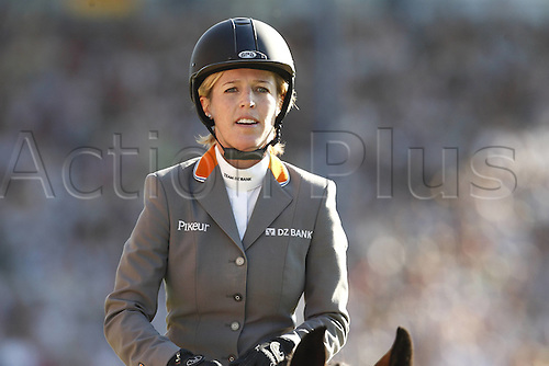 18 07 2010 World Equestrian Festival - CHIO Aachen, Germany 2010, July 9th to 18th, Meredith Michaels Beerbaum celebrates with Shutterfly after finishing second at the Aachen Rolex Grand Prix.