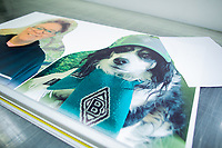 """6th April 2020, North Rhine-Westphalia, Germany;  A test print of two """"cardboard comrades"""" - fans of Borussia Mönchengladbach - , are lying in a printing plant. The fans of Borussia Mönchengladbach want to contribute to a better mood at possible ghost games in the German football league. In order to spare the TV viewers and the professionals the view of the empty stadium seats, cardboard figures with the likeness of the fans are to be set up life-size - if desired, where the spectators also stand or sit during normal games."""