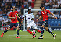 Marcus Rashford (Manchester United) of England goes past Iver Fossum (8) (Hannover 96) of Norway & Mohamed Elyounoussi (Basel) of Norway during the International EURO U21 QUALIFYING - GROUP 9 match between England U21 and Norway U21 at the Weston Homes Community Stadium, Colchester, England on 6 September 2016. Photo by Andy Rowland / PRiME Media Images.