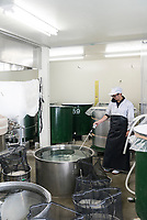 Distillery staff member Takamichi Igarashi checks the temperature of water before washing rice, Nekka Shochu Distillery, Tadami, Fukushima, Japan, February 20, 2018. The Nekka shochu distillery was founded in July 2016 and at that time was the smallest shochu distillery in Japan. It makes shochu from locally-grown rice, and is helping support a local economy that has languished since the nuclear disaster of 2011.