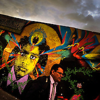 A Colombian businessman walks in front of a graffiti stencil artwork, created by an artist named Stinkfish, in Chapinero, Bogotá, Colombia, 22 February, 2016. A social environment full of violence and inequality (making the street art an authentic form of expression), with a surprisingly liberal approach to the street art from Bogotá authorities, have given a rise to one of the most exciting and unique urban art scenes in the world. While it's technically not illegal to scrawl on Bogotá's walls, artists may take their time and paint in broad daylight, covering the walls of Bogotá not only in territory tags and primitive scrawls but in large, elaborate artworks with strong artistic style and concept. Bogotá has become an open-air gallery of contemporary street art.