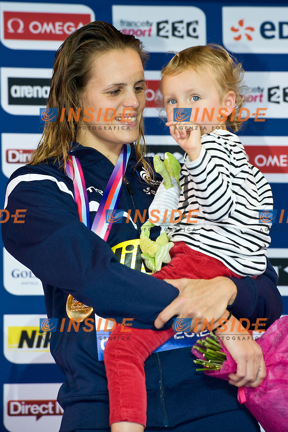 MANAUDOU Laure FRA con la figlia Manon .sul podio dei 100 backstroke Women.XVI European Short Course Swimming Championships.Chartres - FRA France Nov. 22 -25 2012.Day03.Photo G.Scala/Deepbluemedia/Inside