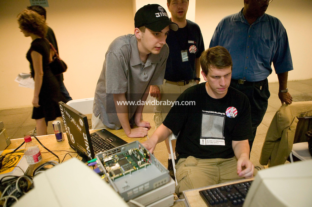 Organizers of the 6th edition of HOPE, an annual hackers' convention, work on setting up a network, July 22nd 2006, New York City, USA.