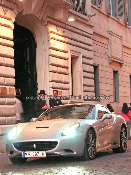 A stylish Ferrari California F1 outside one of the best 5 star hotels in Rome.