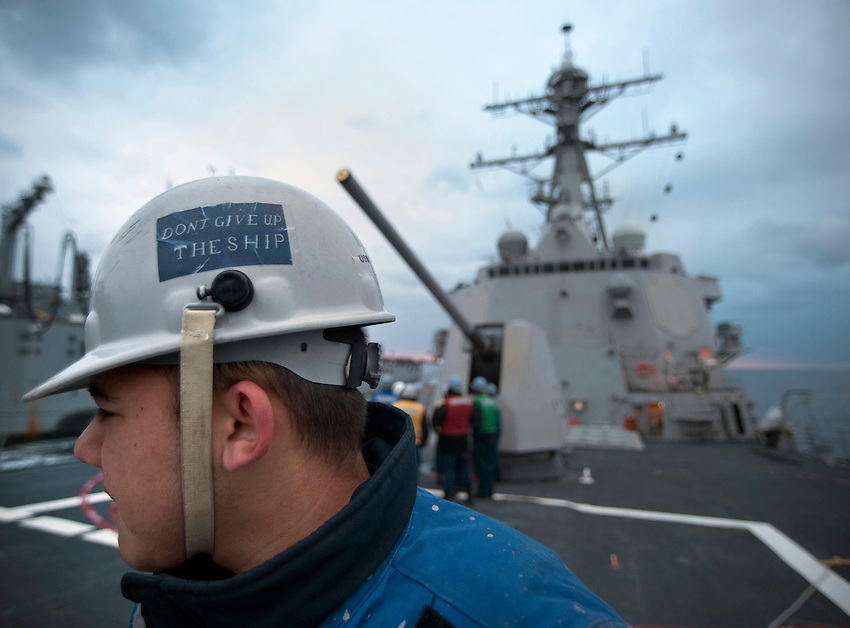 110109-N-7981E-422 PACIFIC OCEAN (Jan. 9, 2011)- Interior Communications Specialist Seaman Apprentice Thomas Olson mans a phone and distance line aboard the Arleigh Burke-class guided missile destroyer USS Gridley (DDG 101) during an underway replenishment with USNS Carl Brashear (T-AKE 7).  Gridley is underway with the Carl Vinson Strike Group on a deployment to the U.S. 7th Fleet area of responsibility. (U.S. Navy photo by Mass Communication Specialist 2nd Class James R. Evans / RELEASED)