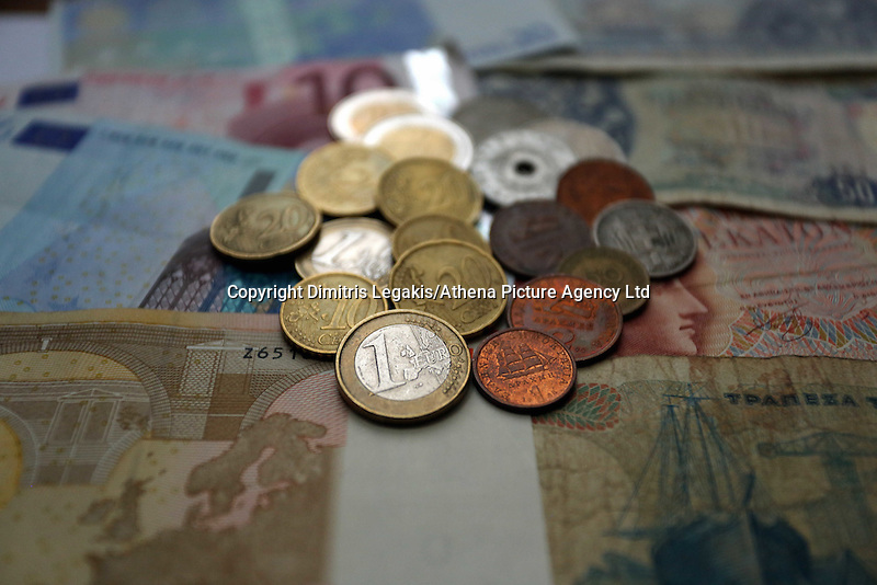 A mixture of old drachma coins and notes along with euros<br />