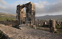 Part of the Roman Basilica, 217 AD, used as courts of justice and city governance, Volubilis, Northern Morocco. Volubilis was founded in the 3rd century BC by the Phoenicians and was a Roman settlement from the 1st century AD. Volubilis was a thriving Roman olive growing town until 280 AD and was settled until the 11th century. The buildings were largely destroyed by an earthquake in the 18th century and have since been excavated and partly restored. Volubilis was listed as a UNESCO World Heritage Site in 1997. Picture by Manuel Cohen