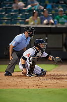 Umpire Ben Sonntag and Jackson Generals catcher Daulton Varsho (5) during a Southern League game against the Mississippi Braves on July 23, 2019 at The Ballpark at Jackson in Jackson, Tennessee.  Mississippi defeated Jackson 1-0 in the second game of a doubleheader.  (Mike Janes/Four Seam Images)