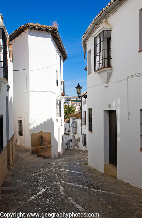 Historic street cobbled street architecture in old city Ronda, Spain