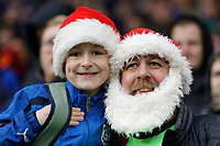 A father and son Cardiff supporters in Santas hats, watch the game during the Sky Bet Championship match between Cardiff City and Preston North End at the Cardiff City Stadium, Wales, UK. Saturday 21 December 2019