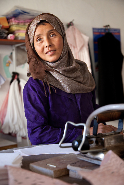 09 May 2012, Bamiyan, Afghanistan : 28 year old Gulchaman working at her station at Poshak Jawanan  tailoring at Mullah Ghulam village on the outskirts of Bamiyan is a small business venture looking to grow and expand both its workforce and output. It is benefiting from the Afghan Rural Enterprise Development Program (REDP). It has been in the program for three months and is hoping to find larger space to get more workers but is hamstrung by the lack of city power to drive its machinery. .The World Bank is funding the REDP in conjunction with the Afghan Government by providing assistance with training for employees, marketing for the products and arranging access to finance to expand and grow the small business venture . Picture by Graham Crouch/World Bank