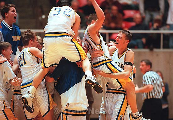 Orem celebrates basketball victory over Layton in the Region 5a semifinals.<br />