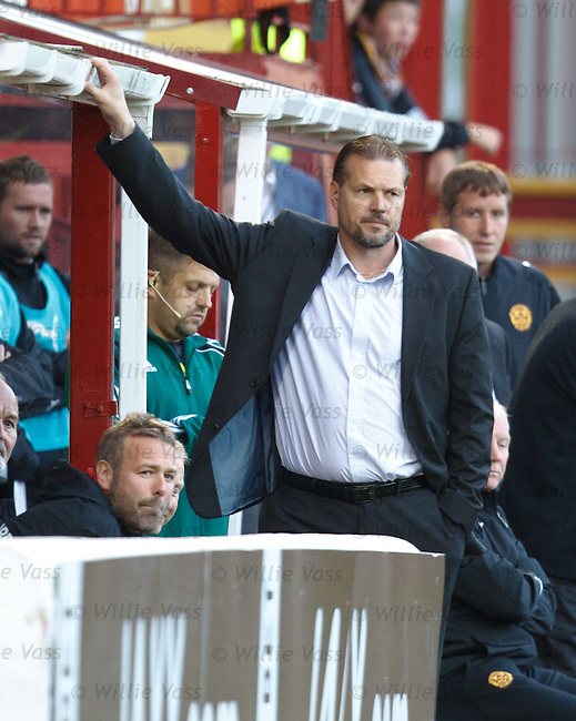 Aalesunds manager Kjetil Rekdal looks rueful after seeing two quick Motherwell goals go in