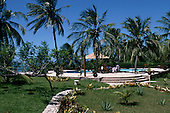 Pipa, Natal, Brazil. Hotel Casa Blanca; the pool of a small hotel with palm trees overlooking the sea.