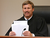 Prince William County (Virginia) Circuit Court judge LeRoy F. Millette, Jr., shuffles through the revised jury instructions at the start of court during the trial of sniper suspect John Allen Muhammad at the Virginia Beach Circuit Court in Virginia Beach, Virginia on November 13, 2003. <br /> Credit: Steve Earley - Pool via CNP