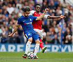Cesc Fabregas of Chelsea tackled by Danny Welbeck of Arsenal during the premier league match at Stamford Bridge Stadium, London. Picture date 17th September 2017. Picture credit should read: David Klein/Sportimage