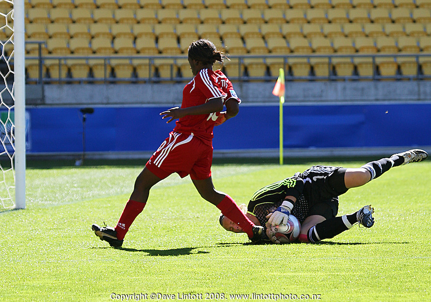 Germany keeper Anna Sarkholz makes a save under pressure from Tiffany Cameron during the FIFA Women's Under-17 World Cup pool match between Germany and Canada at Westpac Stadium, Wellington, New Zealand on Saturday, 8 November 2008. Photo: Dave Lintott / lintottphoto.co.nz