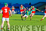 Kilmoyleys Joe McElligott on a solo as Richard Nolan and Tomas O'Connor of Crotta O'Neills attemps to dispossess him in the Senior Hurling Championship Qtr final in Austin Stack Park on Saturday.