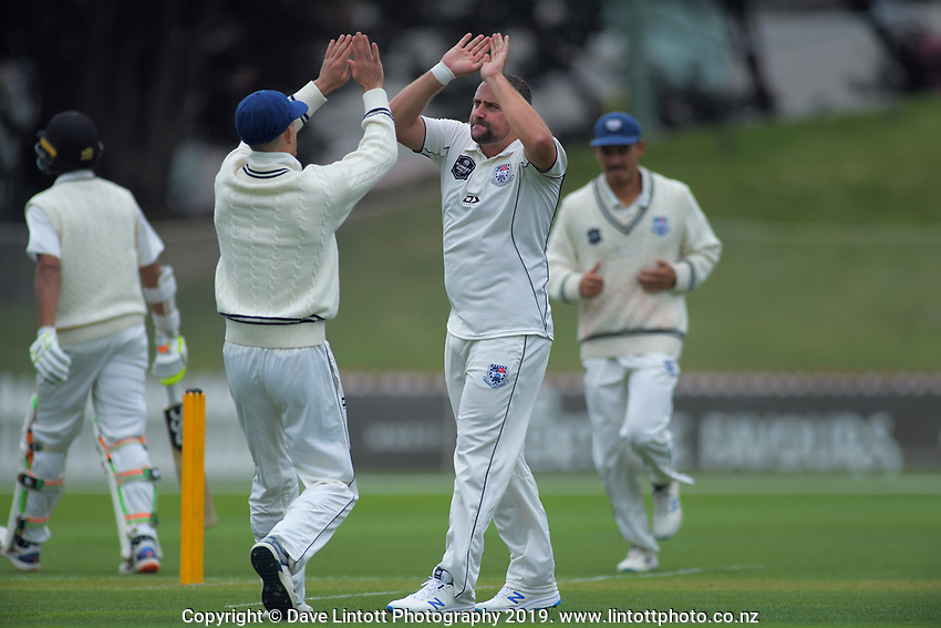 Auckland's Matt McEwen celebrates a wicket during day one of the Plunket Shield cricket match between the Wellington Firebirds and Auckland at Basin Reserve in Wellington, New Zealand on Friday, 8 November 2019. Photo: Dave Lintott / lintottphoto.co.nz