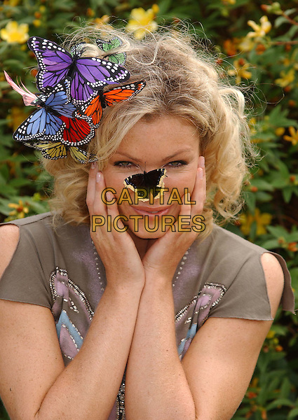 "NELL McANDREW.releases butterflies in Hyde Park .to launch 25th anniversary of ""Debra"" charity.that supports suffers of Epidermolysis Bullosa..butterfly, insect.sales@capitalpictures.com.www.capitalpictures.com.©Capital Pictures.philip treacy butterfly hat, butterflies"