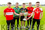 Patrick O'Connor (Dingle), Niall Sheehy (St Brendans), Conor Jordan (Austin Stacks), Kevin Price (Kenmare Shamrocks) and Brendan O'Keeffe (Rathmore) with their hands on the Bishop Moynihan Cup at the launch of the Garvey Senior Football Championship on Monday.