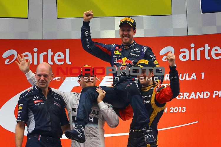25.-27-10-2013, Jaypee-Circuit, Noida, IND, F1, Grosser Preis von Indien, Noida, im Bild Podium - Sebastian Vettel (GER), Red Bull Racing - Nico Rosberg (GER), Mercedes GP - Romain Grosjean (FRA) Lotus Renault F1 Team - <br /> Adrian Newey (GBR), Red Bull Racing (ex. McLaren), Technical Operations Director <br /> for Austria &amp; Germany Media usage only!<br />  Foto &copy; nph / Mathis