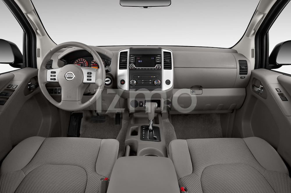Stock photo of straight dashboard view of 2016 Nissan Frontier SV 4 Door Pick-up Dashboard