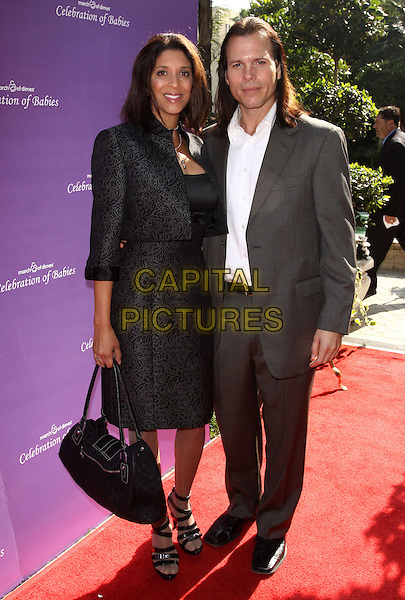 CHRISTINE DEVINE & SEAN McNABB.March of Dimes 4th Annual Celebration of Babies held At The Four Seasons Hotel, Beverly Hills, California, USA,.7th November 2009..half length black suit jacket skirt bag grey gray white shirt fiance couple .CAP/ADM/KB.©Kevan Brooks/AdMedia/Capital Pictures.