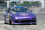 Inglewood, CA 08/07/10 - Kyle Mohan of Kyle Mohan Racing negotiates the gymkhana grid in his 1991 Mazda RX-7 Turbo II at Hollywood Park in Inglewood, California.