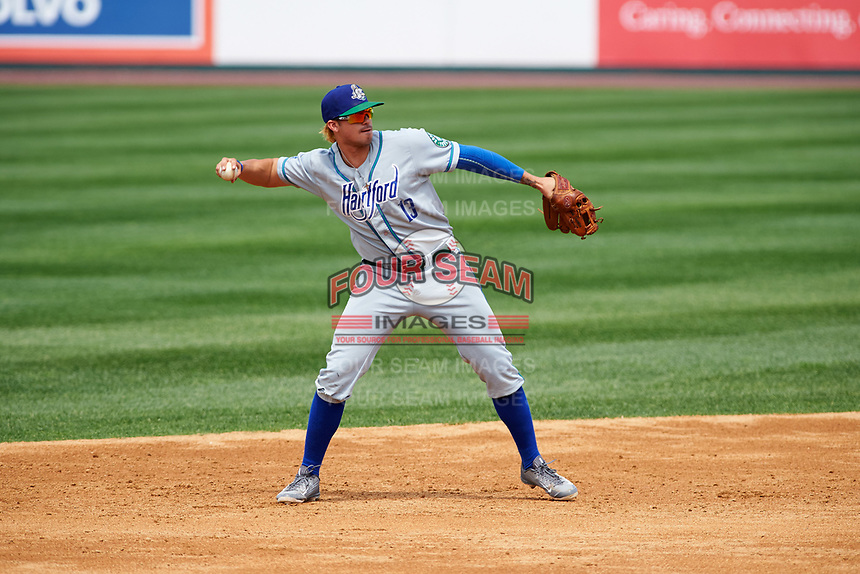 Hartford Yard Goats third baseman Josh Fuentes (13) warmup throw to fist base during a game against the Binghamton Rumble Ponies on July 9, 2017 at NYSEG Stadium in Binghamton, New York.  Hartford defeated Binghamton 7-3.  (Mike Janes/Four Seam Images)