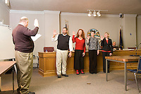 Members of the city council of Silverton Oregon are being sworn in by City Attorney Rich Rodeman, from leeft to right, Kyle Palmer, Stu Rasmussen (Mayor), Sherry Hoefel, Judy Schmidt at the city council chamber in Silverton Oregon
