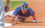 8 March 2015: Boston Red Sox catcher Luke Montz slides safely back to first during Spring Training action against the New York Mets at Tradition Field in Port St. Lucie, Florida. The Mets fell to the Red Sox 6-3 in Grapefruit League play. Mandatory Credit: Ed Wolfstein Photo *** RAW (NEF) Image File Available ***