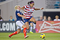 February 9, 2013:   USA Women's National Team forward Sydney Leroux (14) leaps over Scotland defender Rachael Small (3) while trying to control the ball during action between the USA Women's National Team and Scotland at EverBank Field in Jacksonville, Florida.  USA defeated Scotland 4-1............
