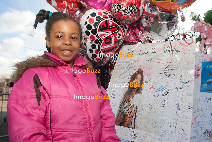 NEWARK, NJ - FEBRUARY 17: Cards and flowers are displayed at a makeshift memorial outside 'The New Hope Baptist Church' on February 17, 2012 in Newark, New Jersey. Whitney Houston was found dead in her hotel room at The Beverly Hilton hotel on February 11, 2012. ..................