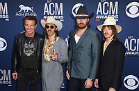 LAS VEGAS, NEVADA - APRIL 07: Dennis Quaid and Jess Carson, Mark Wystrach and Cameron Duddy of Midland attends the 54th Academy Of Country Music Awards at MGM Grand Hotel &amp; Casino on April 07, 2019 in Las Vegas, Nevada. <br /> CAP/MPIIS<br /> &copy;MPIIS/Capital Pictures