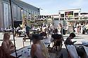 Visitors of Fuorisalone 2016 at the cafeteria area at Ventura street, in Milan, April 14, 2016. &copy; Carlo Cerchioli<br /> <br /> Visitatori del Fuorisalone 2016 nell'area bar in via Ventura, Milano 14 aprile, 2016.