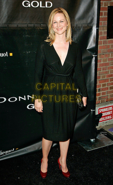 "LAURA LINNEY.at Donna Karan ""Gold"" Fragrance Collection Launch Party at Donna Karan Flagship Store, New York, New York, USA, 12 October 2006..full length black dress.Ref: ADM/JL.www.capitalpictures.com.sales@capitalpictures.com.©Jackson Lee/AdMedia/Capital Pictures."